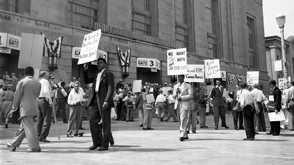 Picketers walking outside of the Democratic National Convention in Philadelphia, demanding equal rights for Black Americans and an Anti-Jim Crow plank in the Party platform, July 12, 1948.