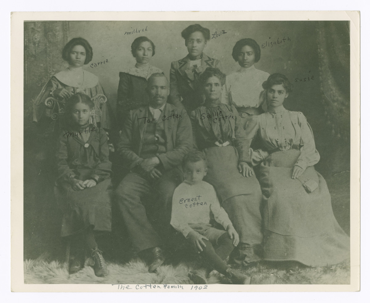 Loula Cotten Williams (standing third from left) is pictured with her parents and siblings, c. 1902. She later relocated to Tulsa, Oklahoma, where she and her husband, John Wesley Williams, owned and operated the Dreamland Theatre.