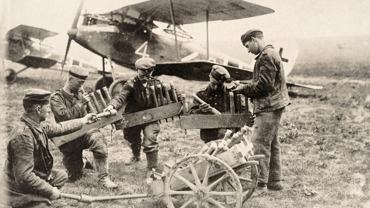 German soldiers loading gas canisters onto military aircrafts during World War I, c. 1915.