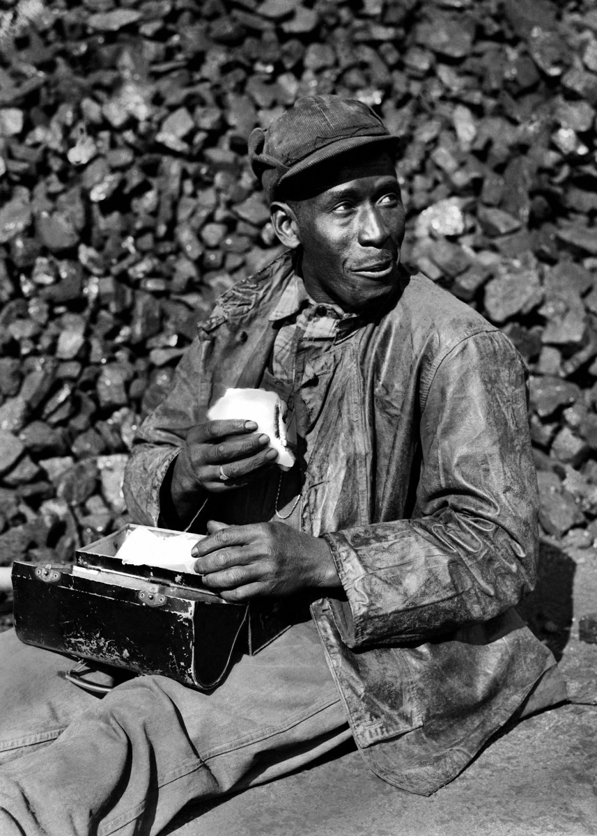 Coal worker in Oak Ridge coal yard in Tennessee, 1945. The town of Oak Ridge was built by the Army Corps of Engineers on isolated farmlandin 1942as part of the Manhattan Project.