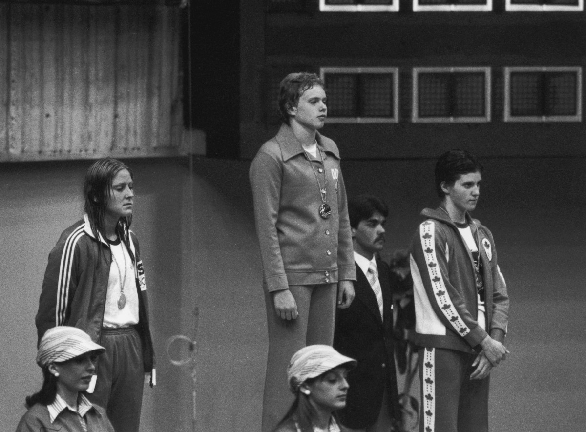 Swimmers receive their medals after the women's 400-meter freestyle event at the Montreal Olympics, July 1976