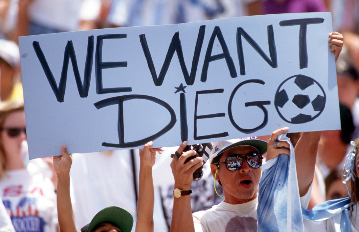 Fans hold up a sign at the 1994 World Cup finals calling for the return of Diego Maradona after he was banned for failing a drug test
