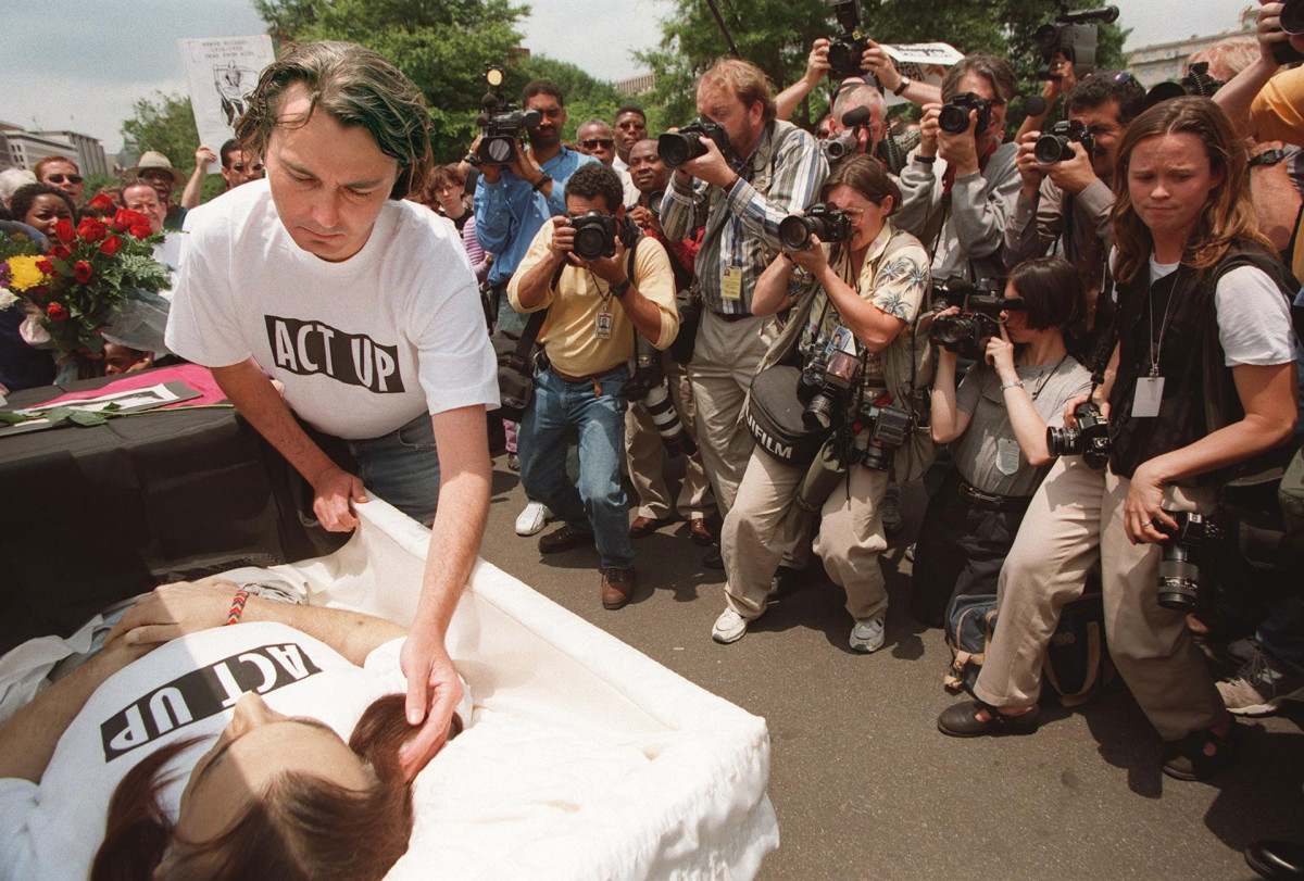 AIDS activistWayne Turnerstrokes the hair of his dead partner Steve Michael during a protest in front of the White House in Washington, D.C. on June 4, 1998. The protesters mourned the death of Michael, ACT UP's Washington, D.C. founder, who died from AIDS on May 25, 1998.