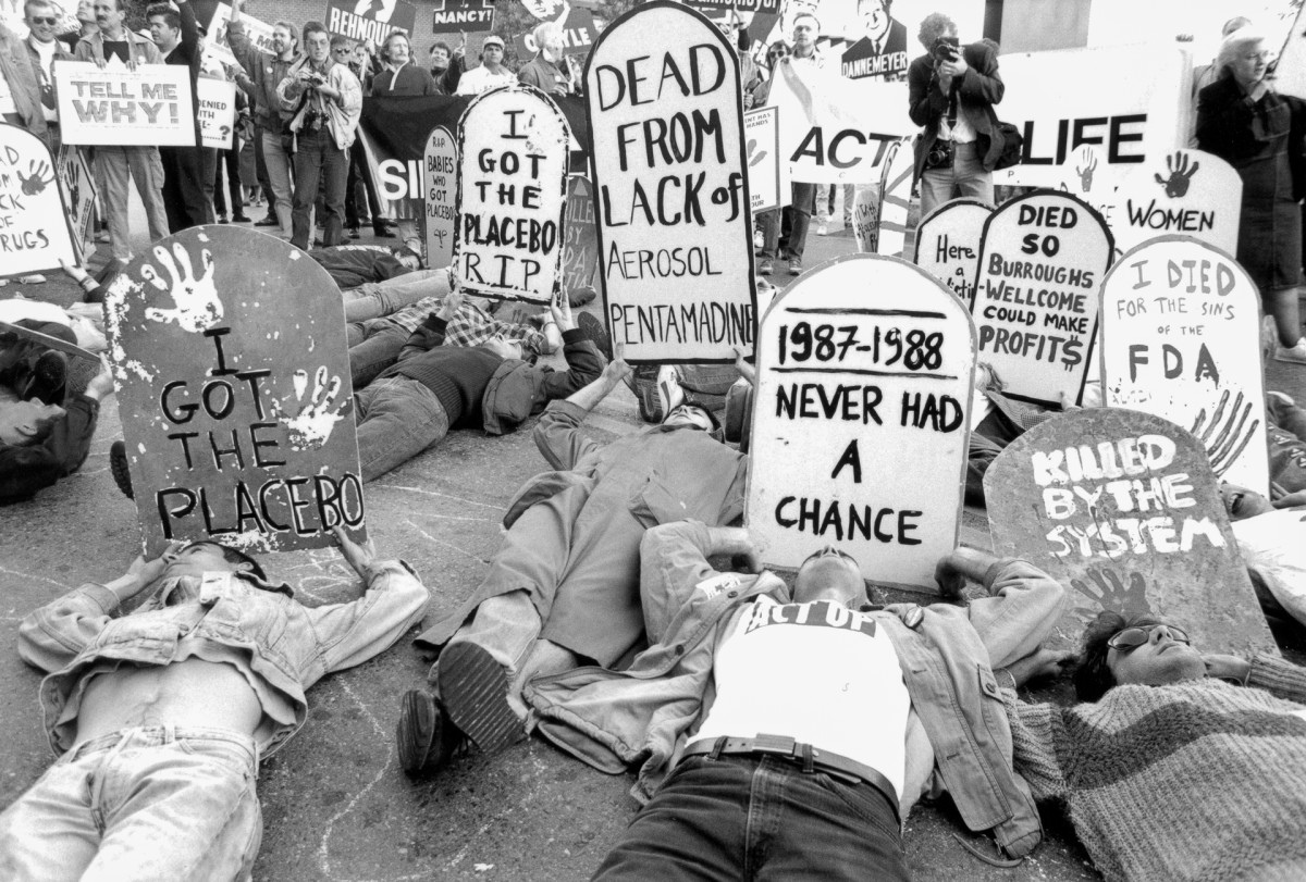 ACT UP protestersoutside the FDA headquarters in Rockville, Maryland on October 11, 1988. Theydemanded the release of experimental medication for those living with HIV/AIDS with slogans reading: 'Never Had A Chance.' 'I Got the Placebo' and 'I Died for the Sins of the FDA.'