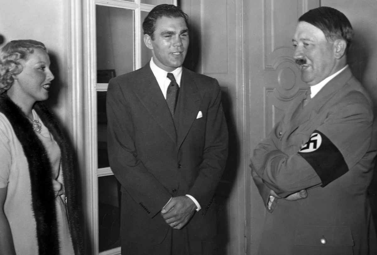 Adolf Hitler pictured with German boxer Max Schmeling and his wife Anny Ondra at the Reich Chancellory in Berlin after Schmeling's victory against Joe Louis in New York, 1936.