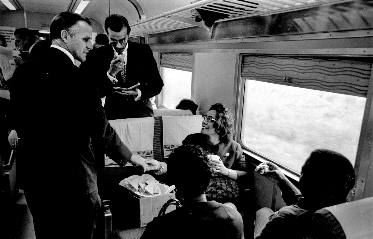 June 8, 1968: Passengers mingled and shared stories on the 8-hour train ride which brought the body of assassinated senator Robert F. Kennedy from New York to Washington, D.C. Here, an unidentified man shakes the hand of Coretta Scott King, widow of Dr. Martin Luther King Jr., who had been killed just two months earlier.