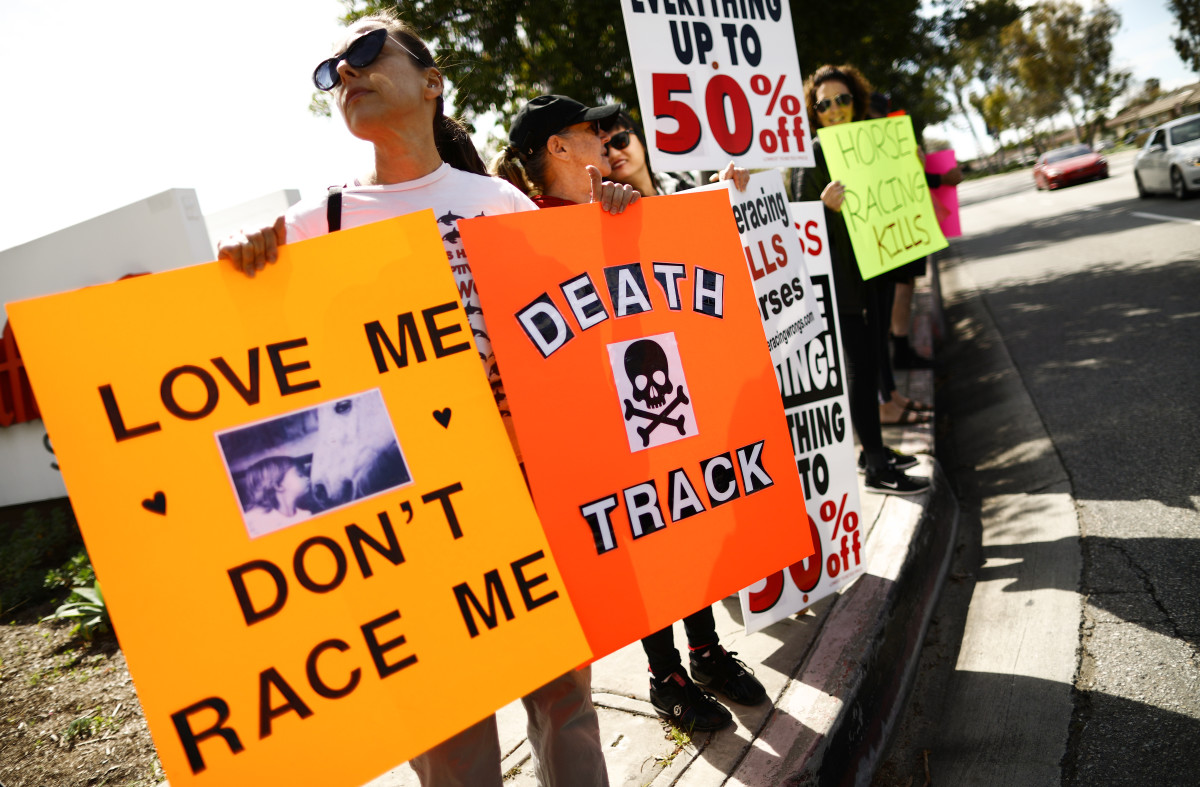 Animal rights activists protest horse racing deaths outside Santa Anita Park on March 10, 2019, in Arcadia, California.