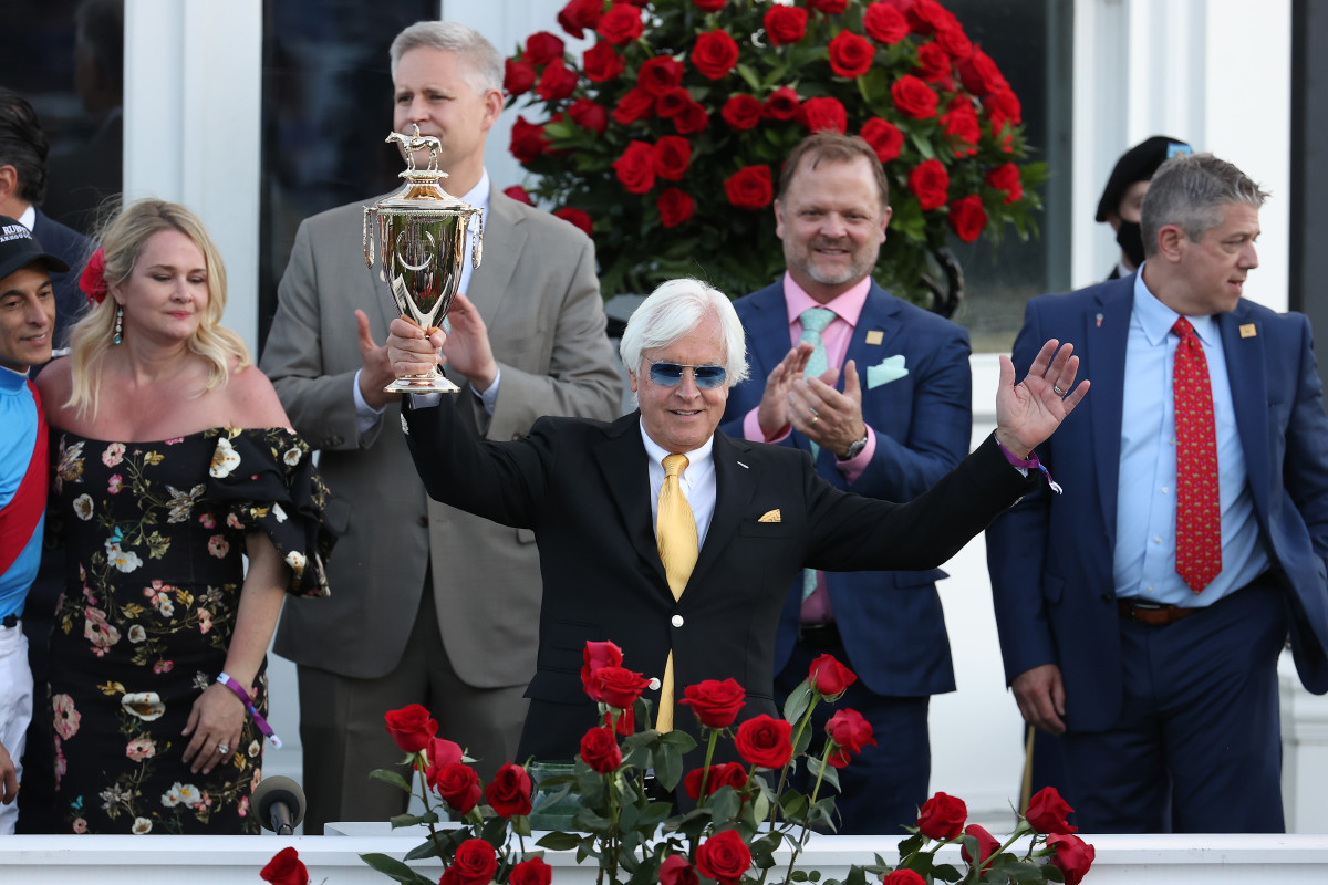 Bob Baffert raises the trophy after winning the 147th running of the Kentucky Derby with Medina Spirit at Churchill Downs on May 1, 2021, in Louisville, Kentucky.