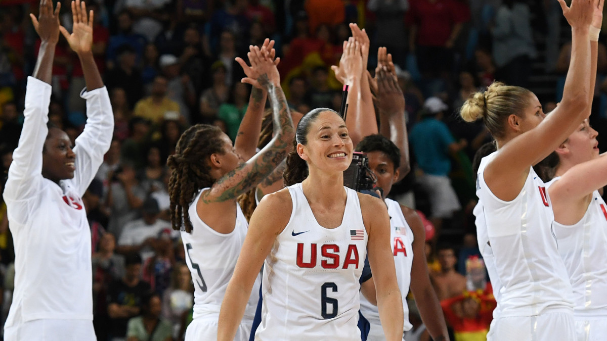 USA's guard Sue Bird reacts as USA's players celebrate after USA defeated Spain during a Women's Gold medal basketball match between USA and Spain at the Carioca Arena 1 in Rio de Janeiro on August 20, 2016 during the Rio 2016 Olympic Games.