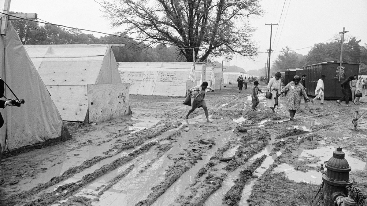 Hundreds of Poor People's Marchers abandoned Resurrection City 5/24 after an all-night rain turned their campsite into a quagmire of yellow mud.