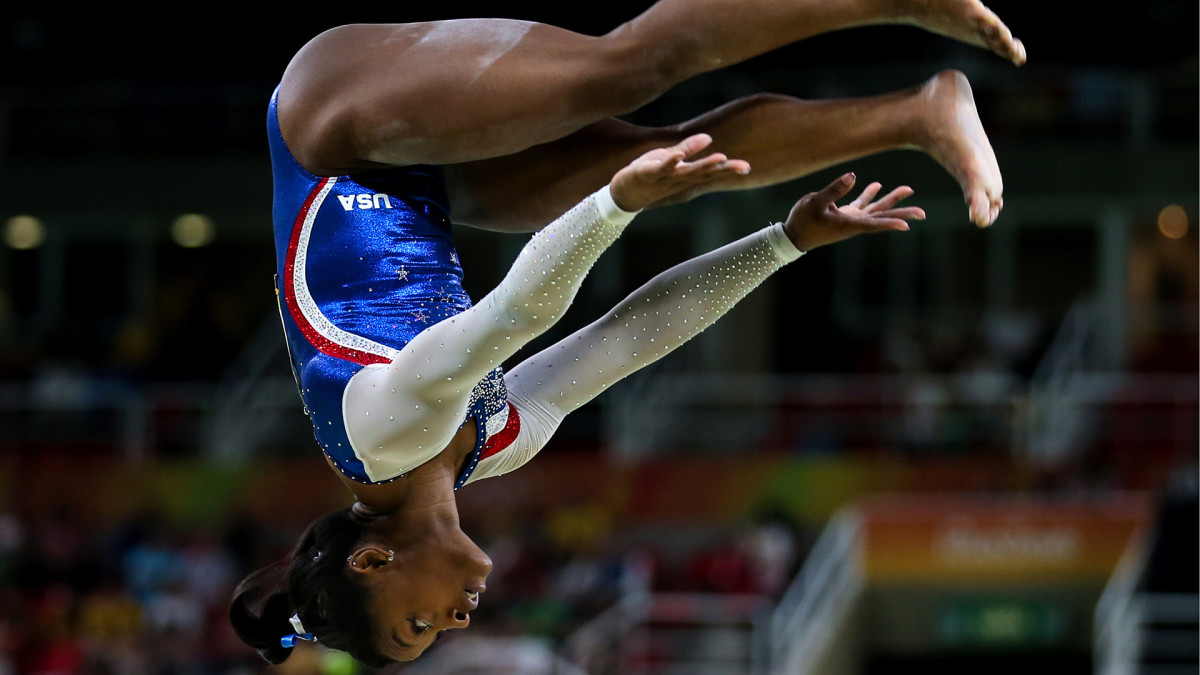RIO DE JANEIRO, BRAZIL - AUGUST 11, 2016: Simone Biles of the USA performs her routine during the artistic gymnastics women's individual all-around final event at the 2016 Summer Olympic Games in Rio de Janeiro, Brazil, at Rio Olympic Arena.