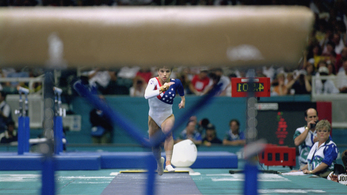 Kerri Strug ATLANTA - JULY 23: Kerri Strug of the United States hurls herself down the runway while competing in the vault, part of the Womens Team Gymnastics competition at the 1996 Olympic Games on July 23, 1996 at the Georgia Dome in Atlanta, Georgia