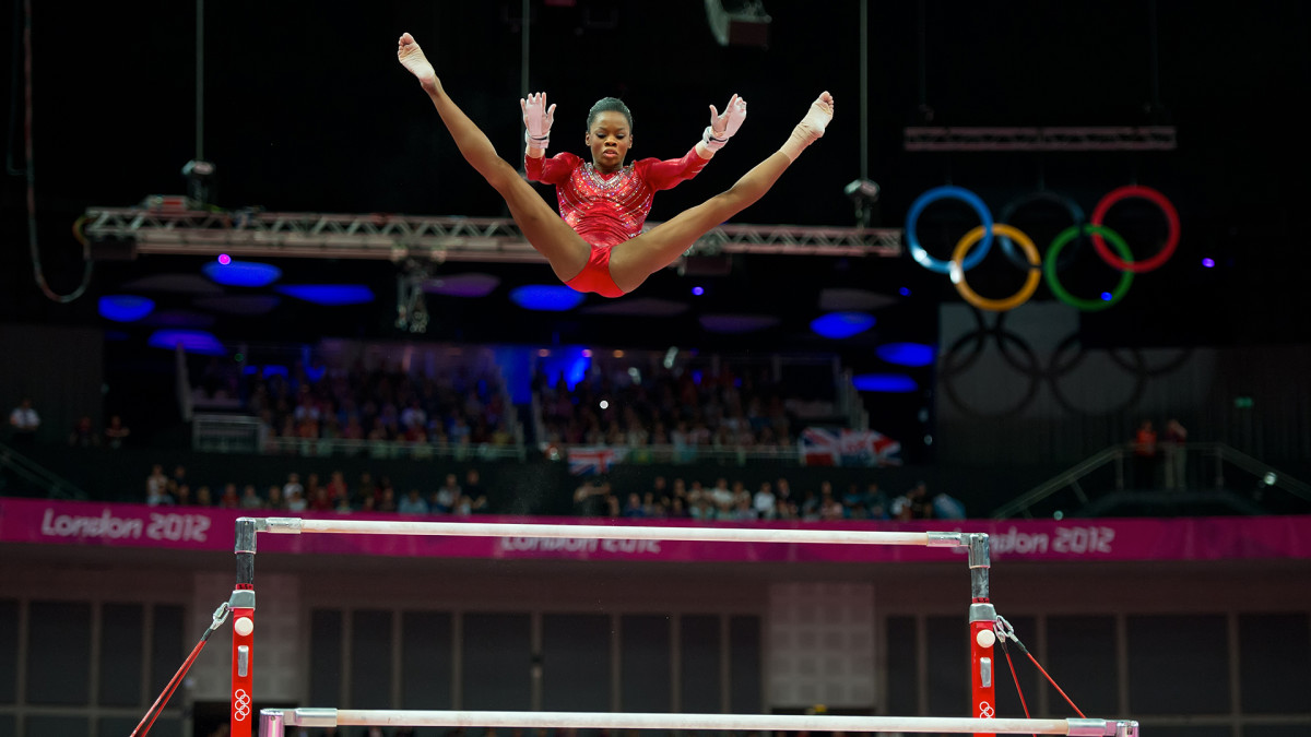 Gabrielle Douglas of the United States soared over the uneven bars apparatus during women's team gymnastics finals at North Greenwich Arena during the 2012 Summer Olympic Games in London, England, Tuesday, July 31, 2012.