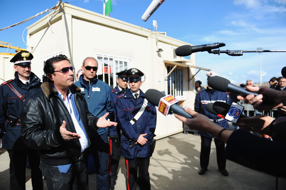 Former Captain of the Costa Concordia Francesco Schettino speaks with reporters after being aboard the ship with the team of experts inspecting the wreck on February 27, 2014 in Isola del Giglio, Italy. The Italian captain went back onboard the wreck for the first time since the sinking of the cruise ship on January 13, 2012, as part of his trial for manslaughter and abandoning ship.