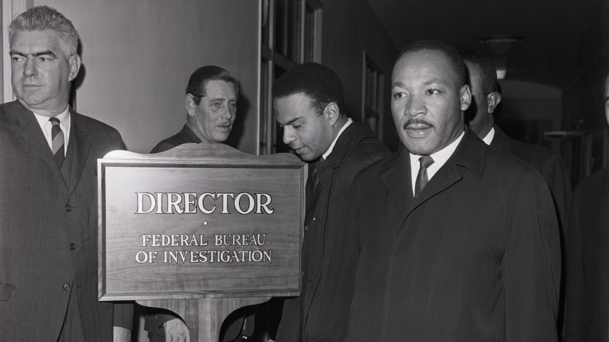 Martin Luther King Jr. arriving at the Federal Bureau of Investigation to speak with director J. Edgar Hoover, who had publicly called the civil rights leader a 'notorious liar.'