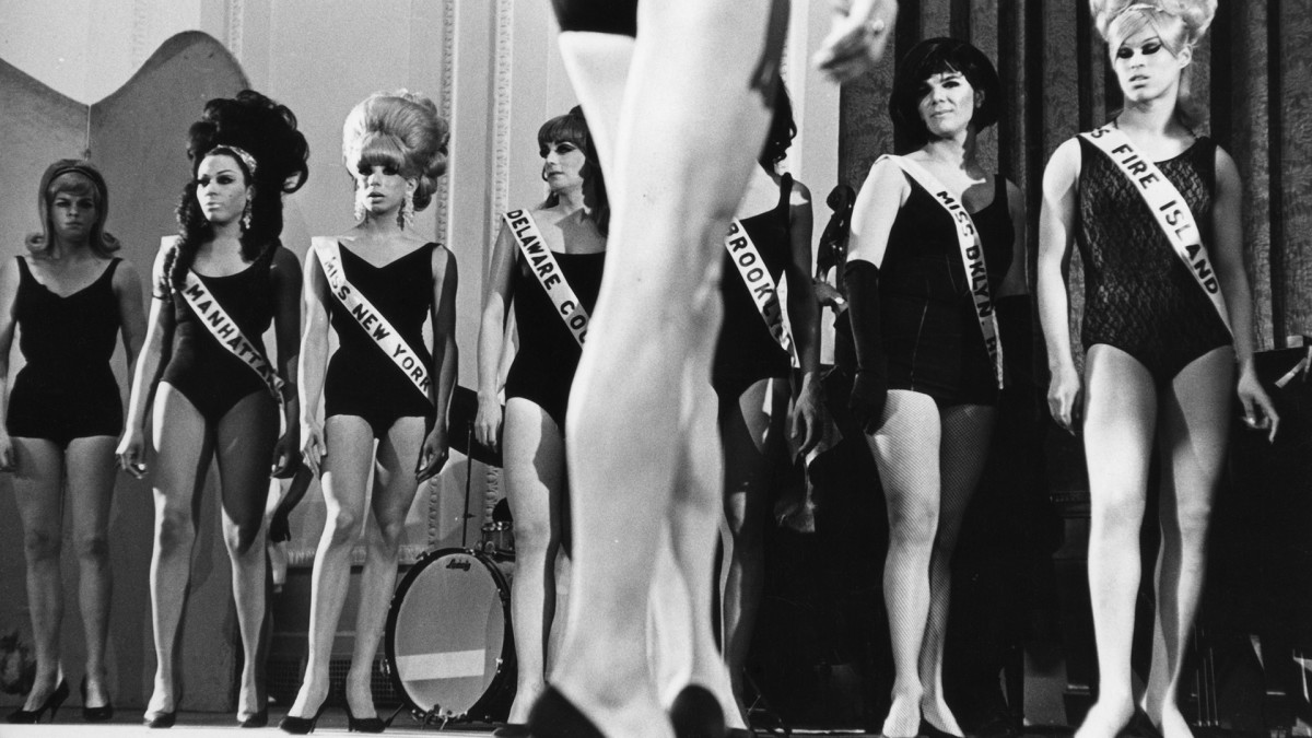 View of a line of drag performers onstage as they compete during a beauty contest, New York, New York, February 20, 1967. Among those pictured are Miss Manhattan, Miss New York, Miss Delaware County, Miss Brooklyn, and Miss Fire Island.