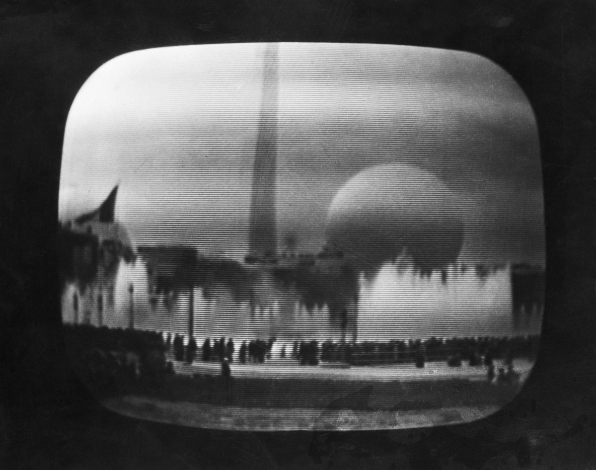 April 30, 1939, New York City: This is the scene viewed on the television receivers in the metropolitan area, as the National Broadcasting Company inaugurated the first regular television service to the American public telecasting the ceremonies marking the opening of the New York World's Fair. Later, viewers heard and saw President Roosevelt proclaim the fair open.