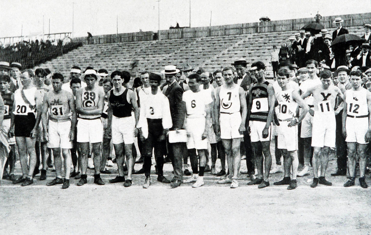 Marathon runners line up before the start of the race, which was won by United States' Thomas Hicks.