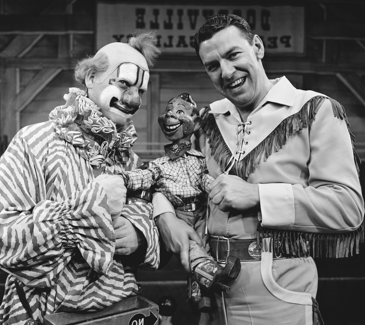 Pictured: (l-r) Lew Anderson as Clarabell the Clown, Howdy Doody, Bob Smith as Buffalo Bob Smith