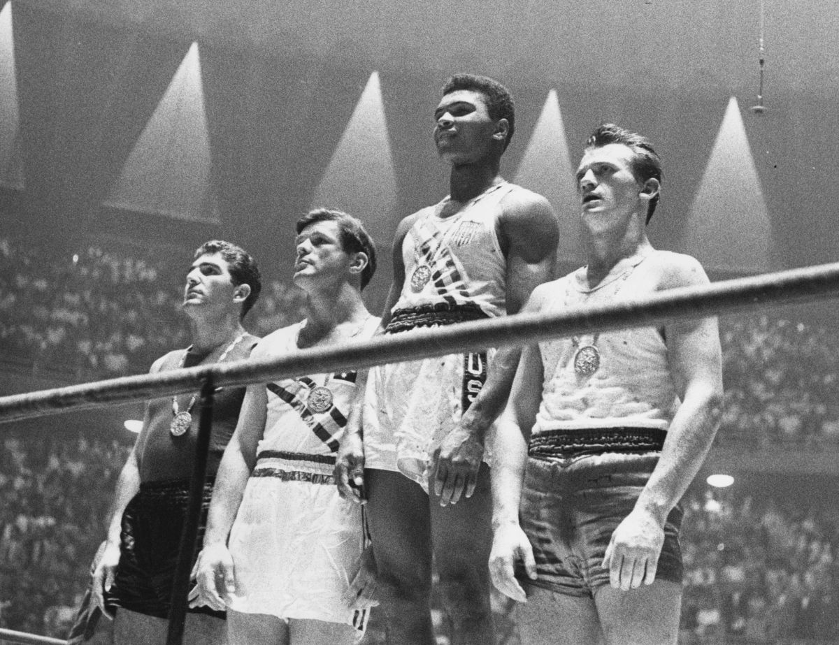 Cassius Clay, center right, at the 1960 Olympic Games in Rome