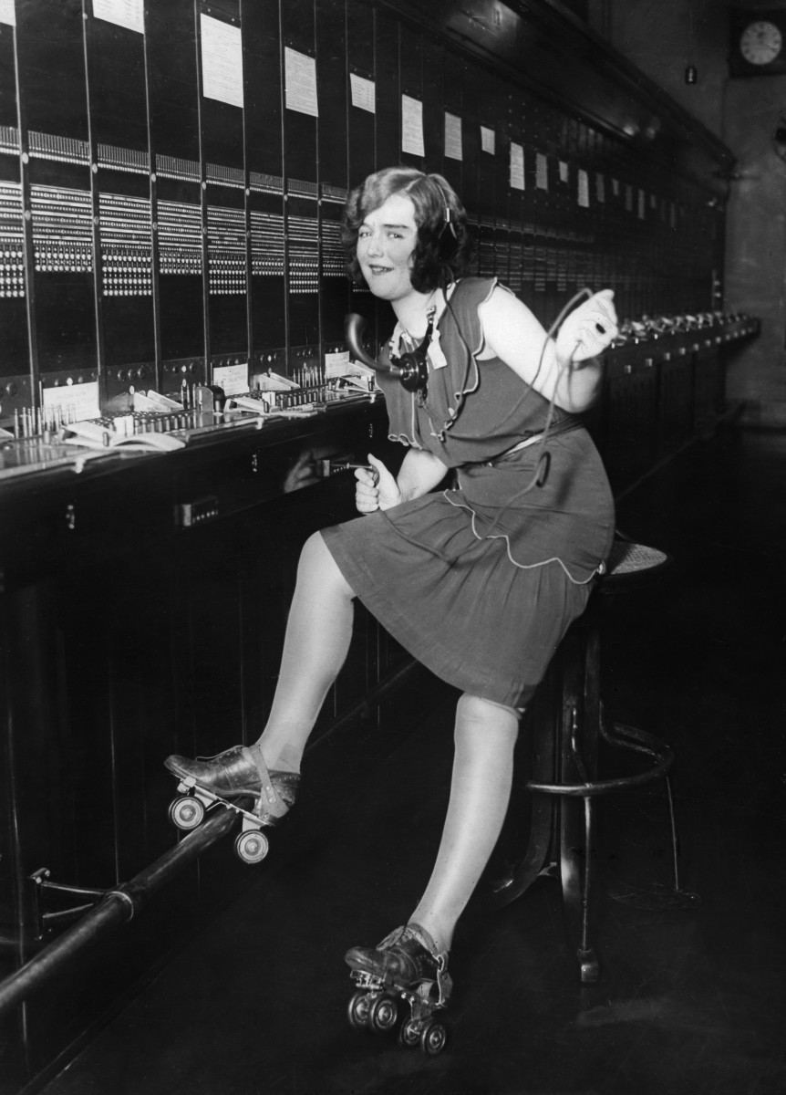 A switchboard operator on roller skates on night shift in the telecommunications office of San Francisco - 1929