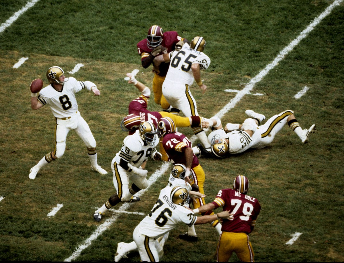 New Orleans Saints quarterback Archie Manning looks to pass in a 41-3 loss to the Washington Redskins on September 21, 1975 at RFK Stadium in Washington, D.C. (Photo by Nate Fine/Getty Images)