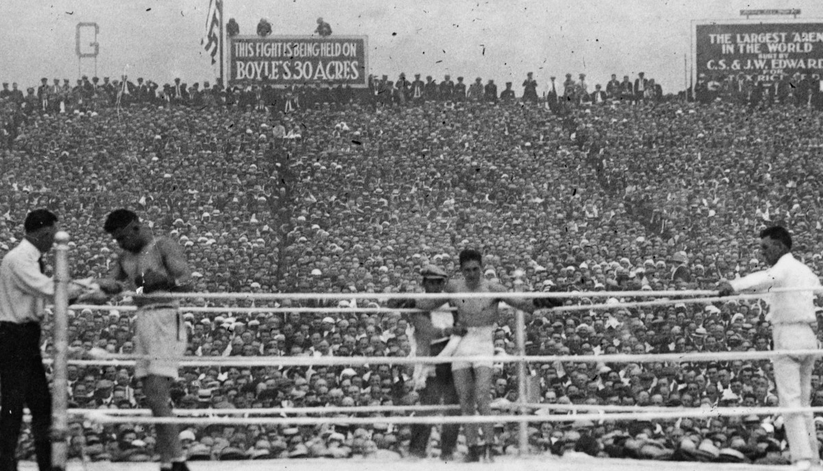 JERSEY CITY,NJ - JULY 2,1921: Jack Dempsey (L) rest in his corner as Georges Carpentier stands in his during the fight at Boyle's Thirty Acres,on July 2,1921 in Jersey City, New Jersey. Jack Dempsey won the National Boxing Association World heavyweight title and World Heavyweight Title by a KO 4.(Photo by: The Ring Magazine via Getty Images)