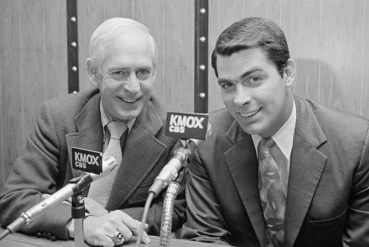 Mike Shannon (R) former Cardinal third baseman, will join Jack Buck (L) in broadcasting the 1972 St. Louis Cardinal baseball games. Shannon, 32, was sidelined with a kidney ailment in 1970 and worked for the Cardinal front office in promotion and sales this year. Buck and Shannon, at the announcement, said Buck will do the complete play by play and Shannon the color and commentary on the game.