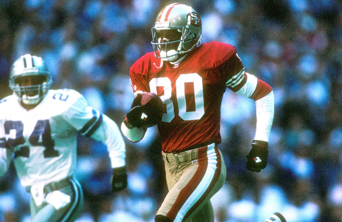 IRVING, TX - NOVEMBER 12: Wide receiver Jerry Rice #80 of the San Francisco 49ers races to the endzone against the Dallas Cowboys at Texas Stadium in Irving, Texas on November 12, 1995. The 49ers defeated the Cowboys 38-20. (Photo by Joseph Patronite/Getty Images)