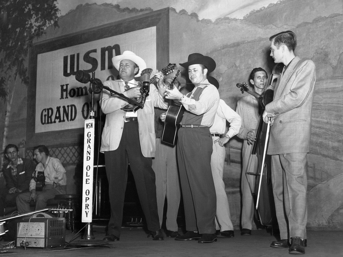 Bluegrass singer songwriter Bill Monroe performs with Jimmy Martin (Buddy Killen on Bass, Don Slayman on fiddle) on stage at the Grand Ole Opry in 1951 in Nashville, Tennessee.