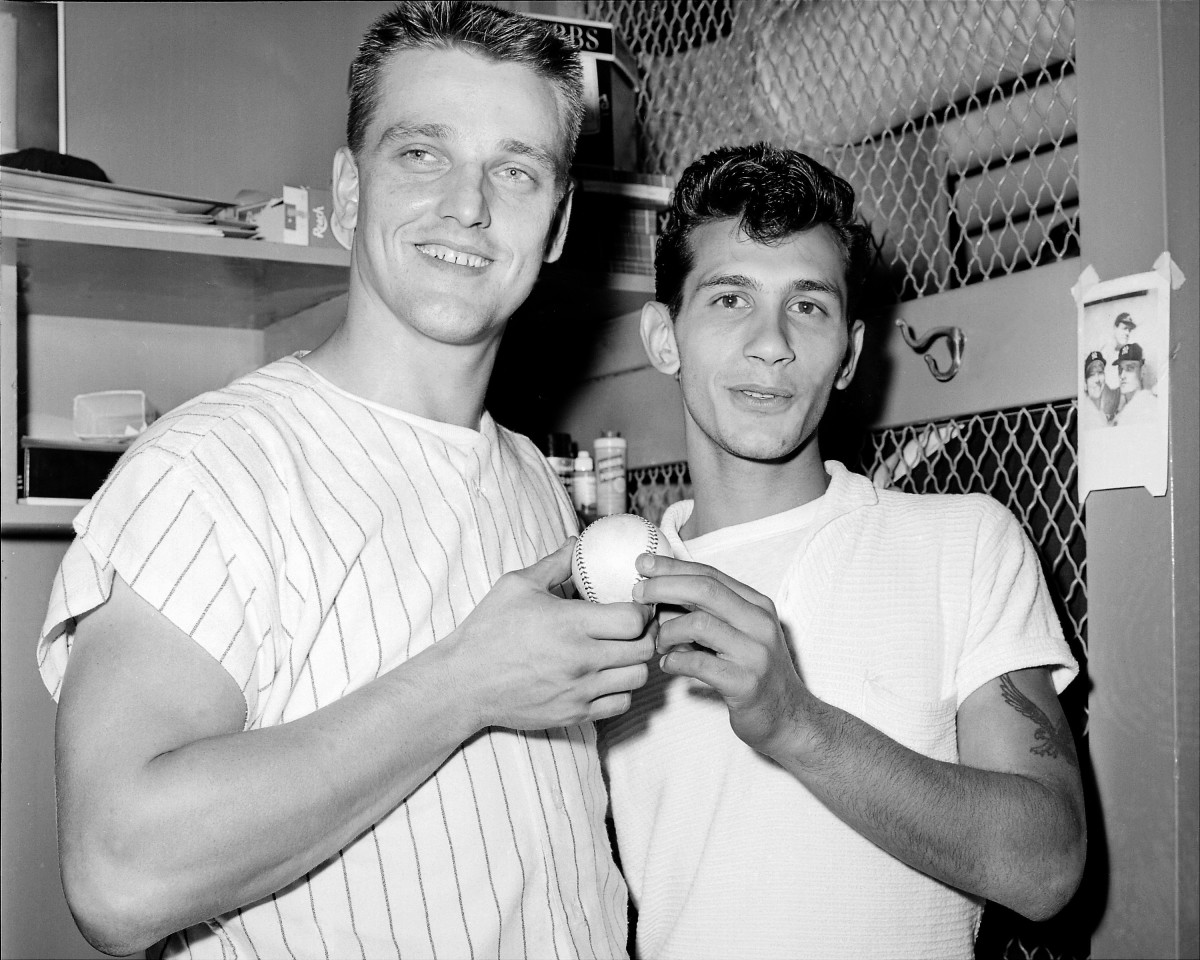 BRONX, NY - OCTOBER 1: Sal Durante, 19, presents Roger Maris #9 of the New York Yankees with the ball he laced 360 feet for his 61st homer of the year against the Boston Red Sox on October 1, 1961 at Yankee Stadium in Bronx, New York. Maris is first man to top Ruth's 60 mark (though in a longer season). For Sal, the catch means $5,000 prize money offered to fan who caught 61st homer and returned it to Roger. (Photo by Jim Mooney/NY Daily News Archive via Getty Images)