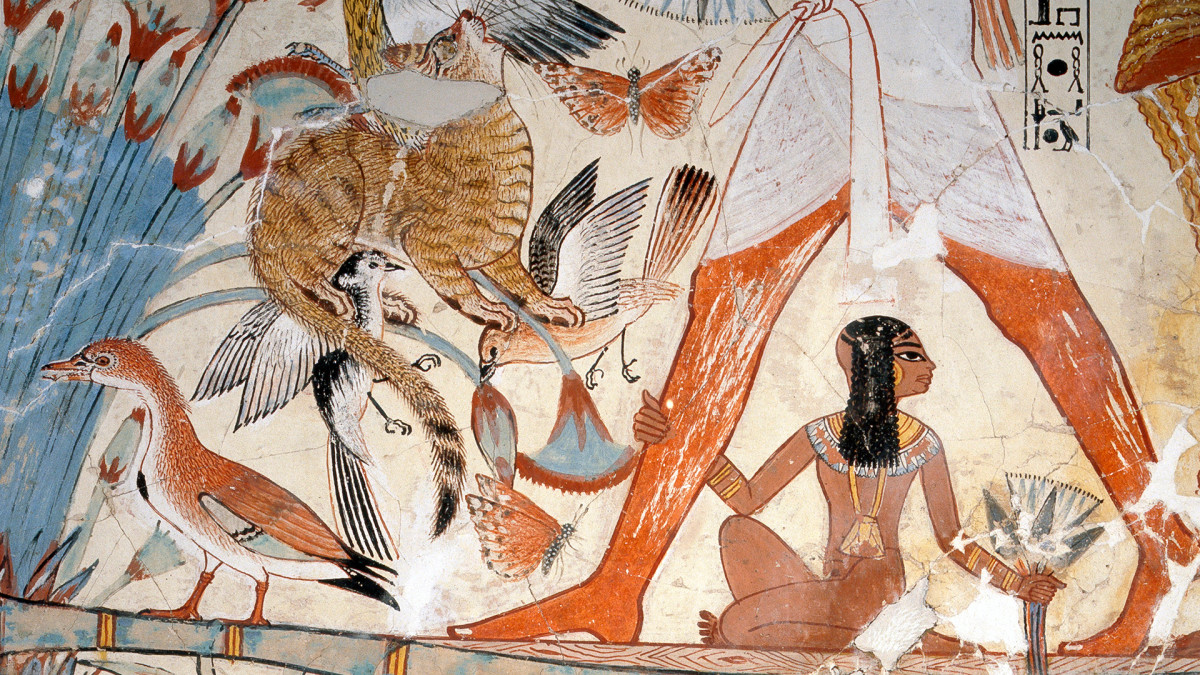 A detail of a painting from the tomb of Nebamun showing him standing on a reed boat hunting birds in the papyrus marshes using throwsticks and three decoy herons, His cat has grabbed three birds.
