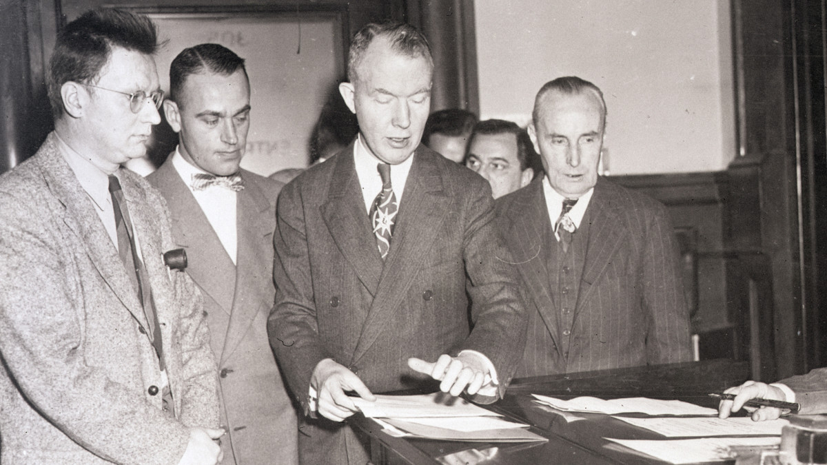 Clarence Hiskey (at left), former physics professor and atomic scientist, appears in Brooklyn federal court on November 11, 1950. Hiskey was one of 12 indicted in Washington on a Contempt of Congress charge for refusing to answer questions of the Committee on Un-American Activities.