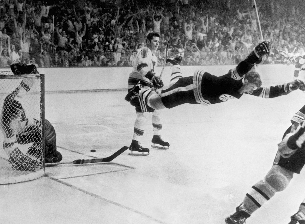 Bobby Orr of the Boston Bruins soars after scoring the Stanley Cup-winning goal against the St. Louis Blues in 1970.