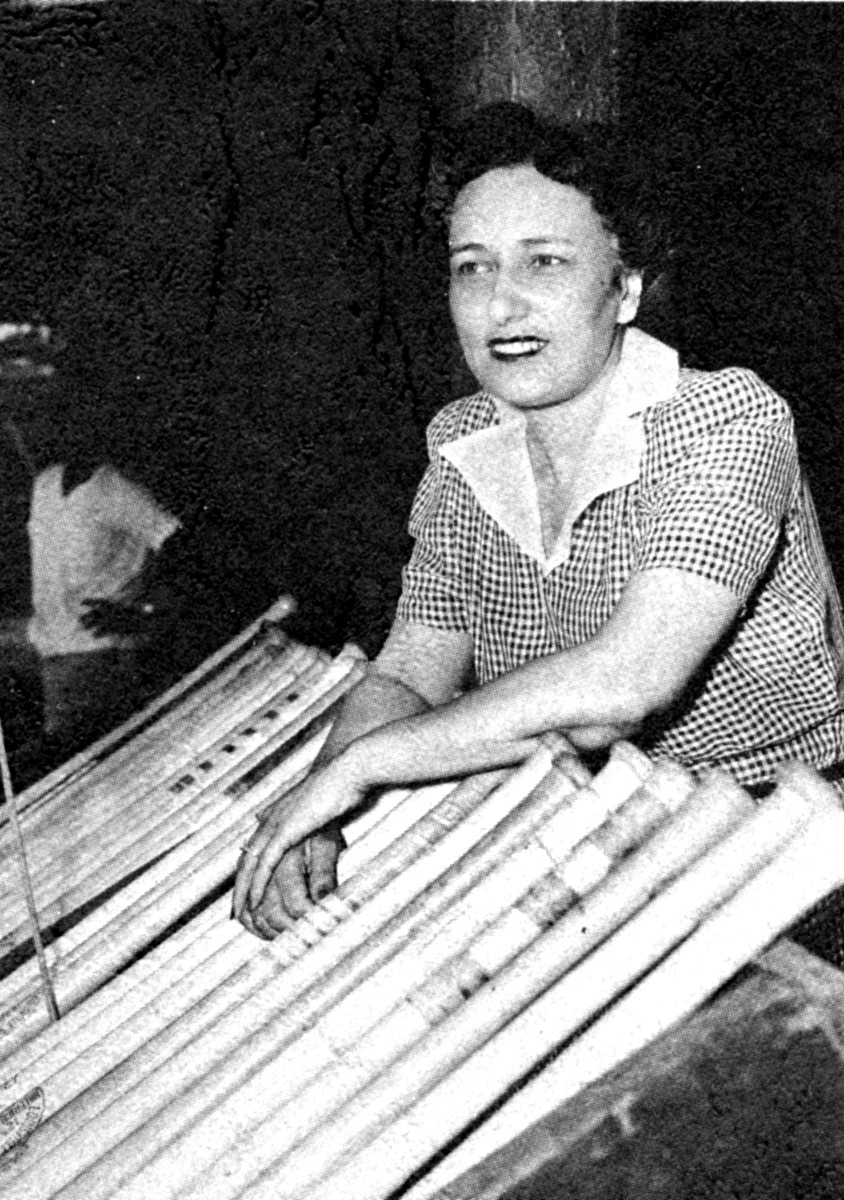 Newark Eagles co-owner Effa Manley poses with bats in the dugout in Ruppert Stadium in Newark, N.J., in 1948–the year the Negro League team disbanded.