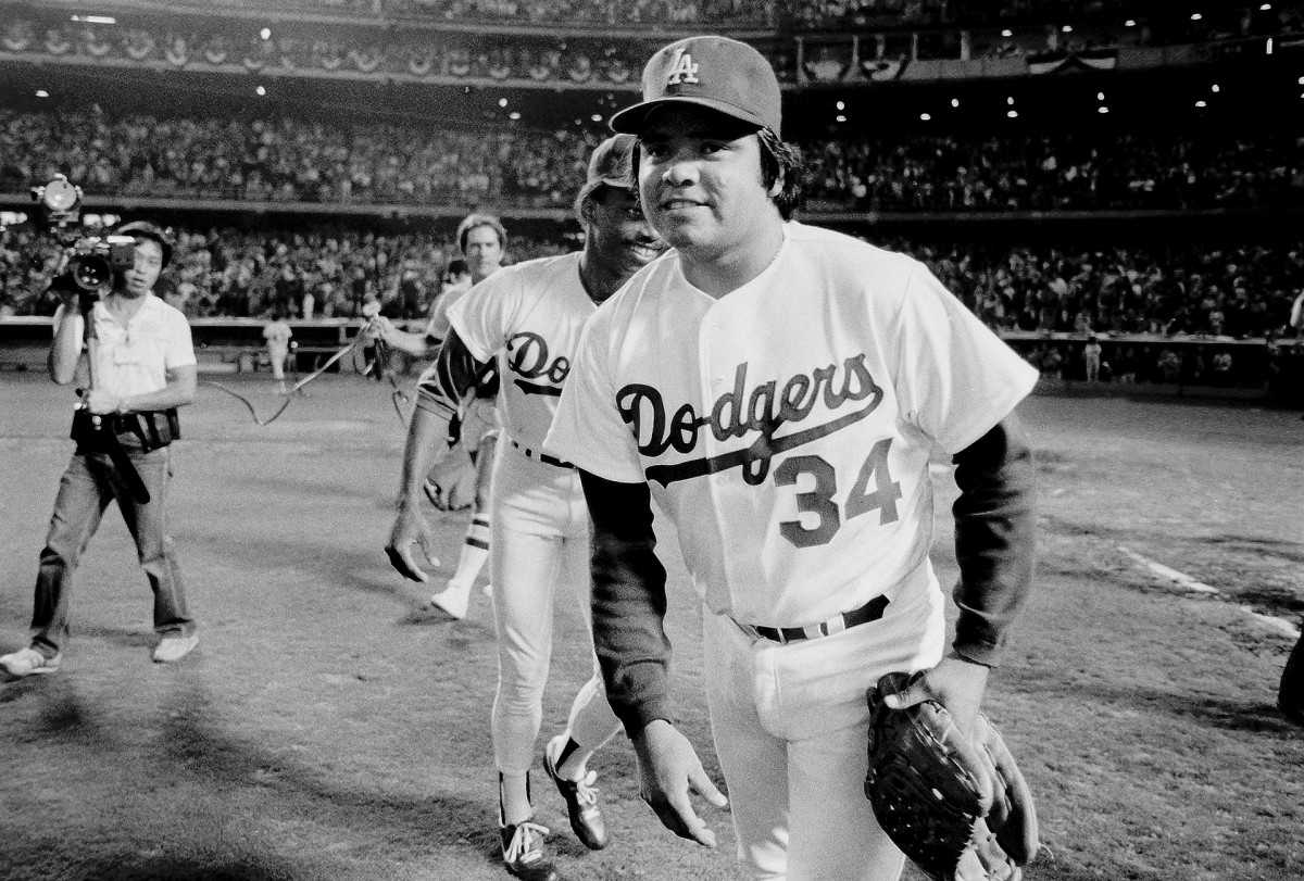 Fernando Valenzuela #34 of the Los Angeles Dodgers walks off the field after defeating the Houston Astros during the 1981 National League Division Series at Dodger Stadium, Los Angeles, California.