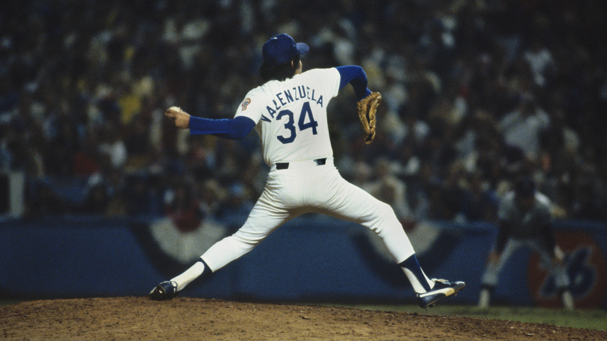 Pitcher Fernando Valenzuela #34 of the Los Angeles Dodgers pitches against the New York Yankees during Game 3 of the 1981 World Series at Dodger Stadium on October 23, 1981 in Los Angeles, California. The Dodgers defeated the Yankees 5-4. (Photo by Focus on Sport via Getty Images)