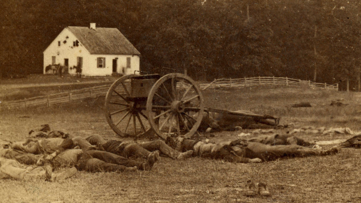 Several dead Confederate artillery men lie outside Dunker Church after the Battle of Antietam. The church was the location of some of the bloodiest fighting during the battle. September 19, 1862.