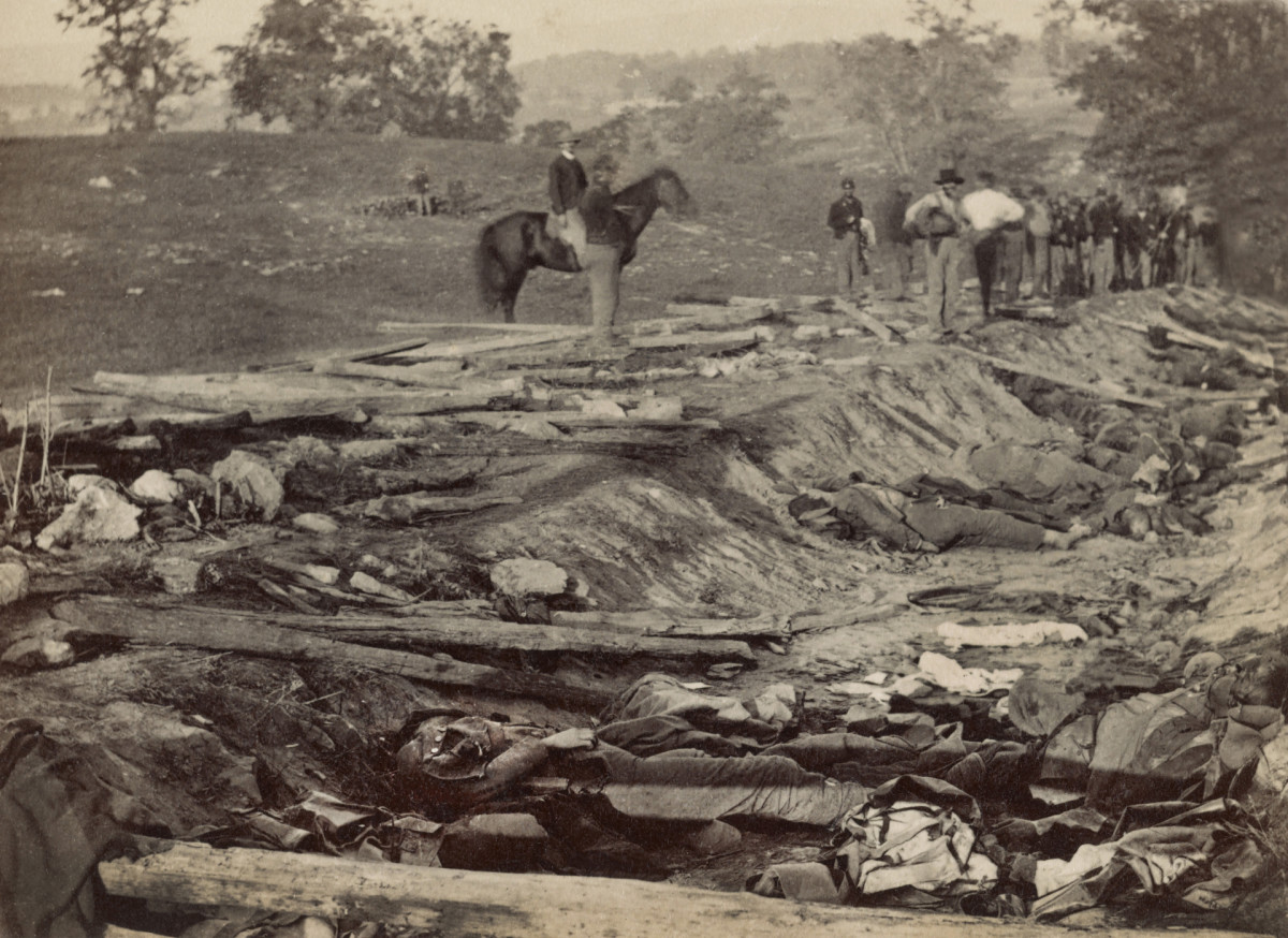 A ditch, called 'Bloody Lane,' with bodies of dead Confederate soldiers awaiting burial after the Battle of Antietam, photographed by Alexander Gardner, September 19, 1862.