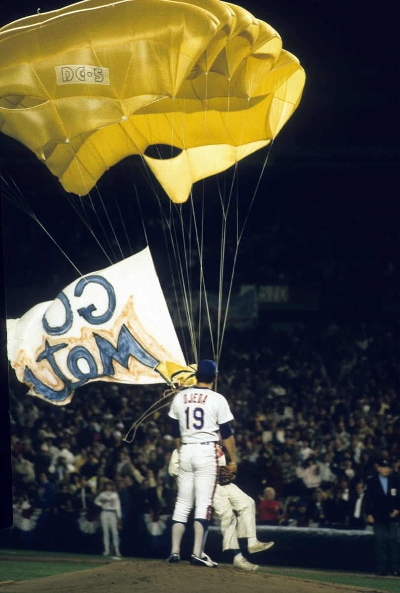 Actor Michael Sergio parachutes onto the field during the first inning of Game 1 of the 1986 World Series.