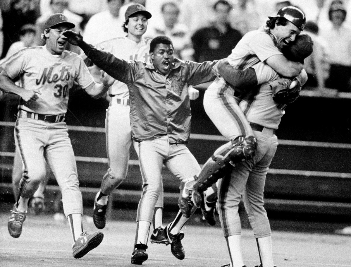 Catcher Gary Carter leaps into the arms of pitcher Jesse Orosco after the Mets clinched the National League pennant.
