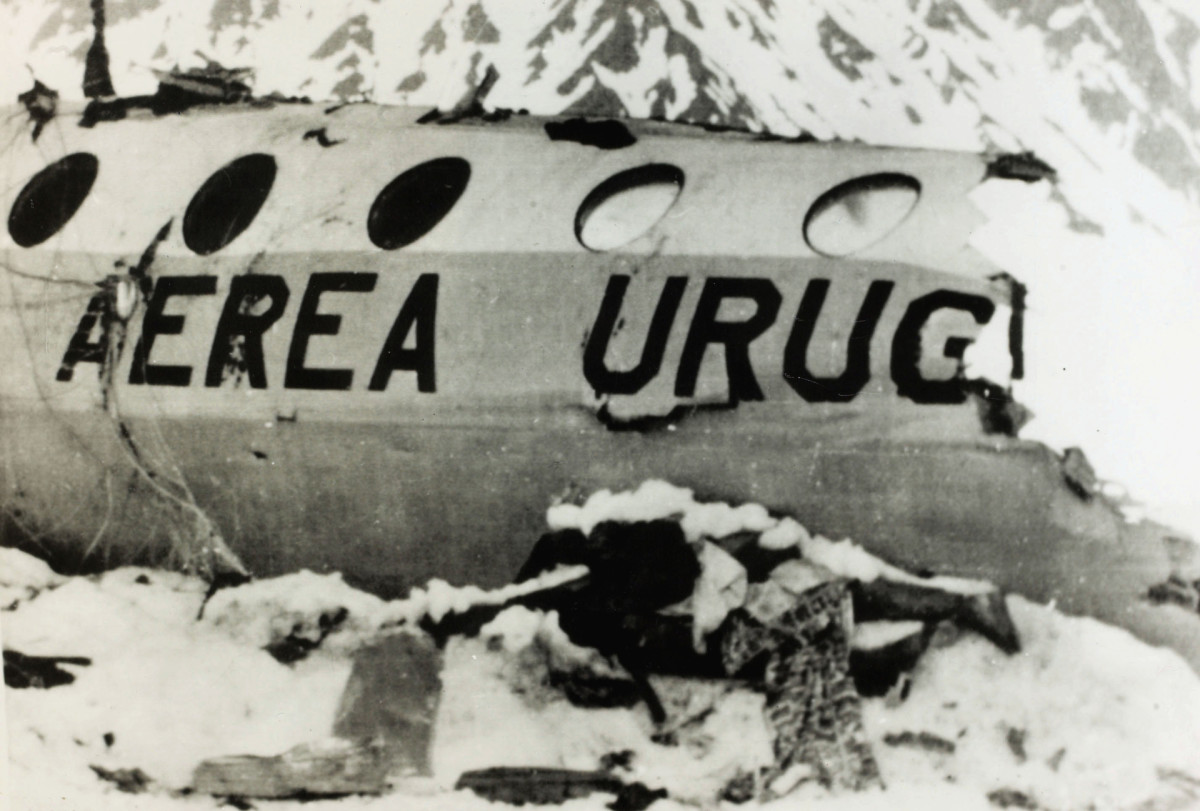 A dead body from the Andes Flight Disaster lies near the wreckage.
