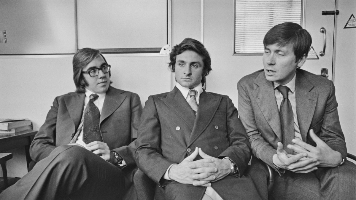 Nando Parrado (left) and Roberto Canessa (center), former members of the Uruguayan rugby team who survived the air crash of Flight 571, attending a press conference after their experiences were documented in the book 'Alive: The Story of the Andes Survivors' by Piers Paul Read (right), 1974.