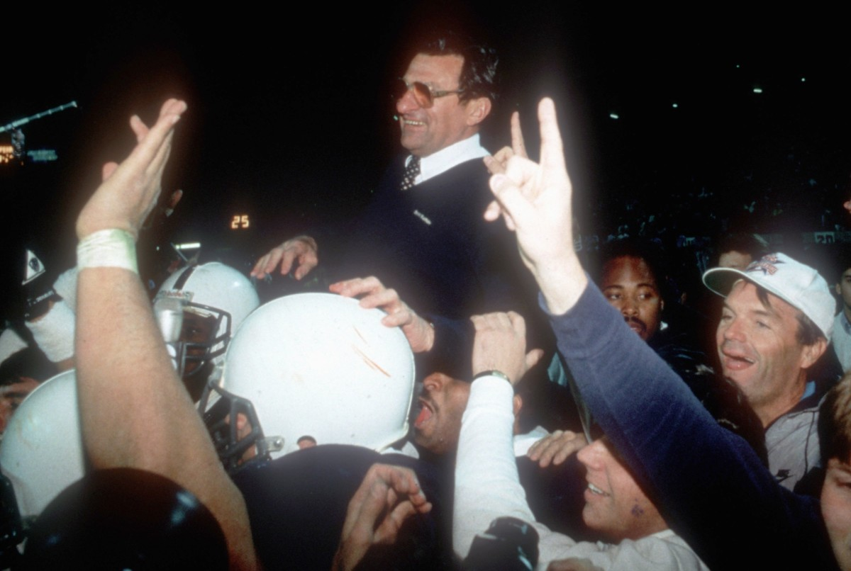 Penn State coach Joe Paterno celebrates his team's upset of Miami with fans at the Fiesta Bowl.