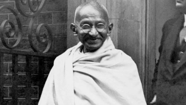 Gandhi Speaks to Press Upon Arrival in London